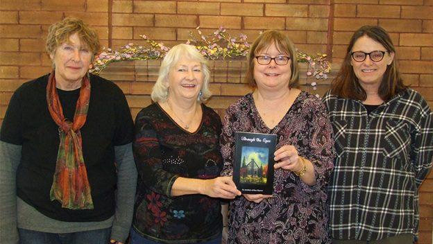 Vine Rhymes chair Anne Tener, founder Helen Latimer-Hanah, Head Librarian Karen Schecter, and Vine Rhymes co-founder Beth Bernhardt.