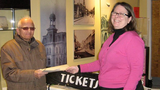 Ann Hawthorne of Tickets Please gives a bloc of Classic Theatre Festival benefit tickets to Choulgere Guruprasad