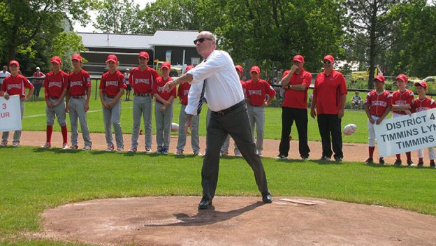 Mayor of perth throws the first pitch at the provincial major league championships.