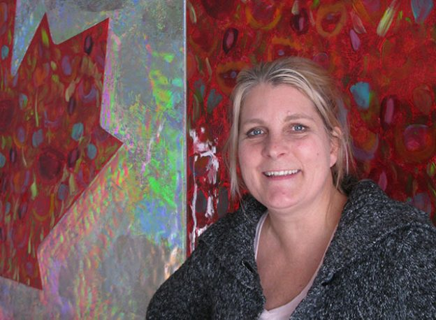 Sarah Moffat in front of her Canadian Flag art piece.