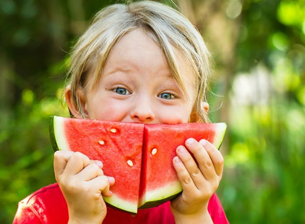 Child with a watermelon smile