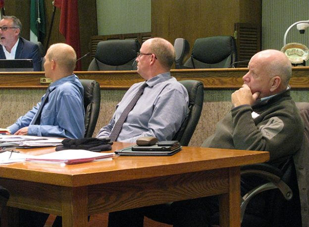 Karl Grenke, Troy Dunlop, Director of Public Works and Art Manhire, Manager of Community Services listen intently to Councillor Chris Cummings