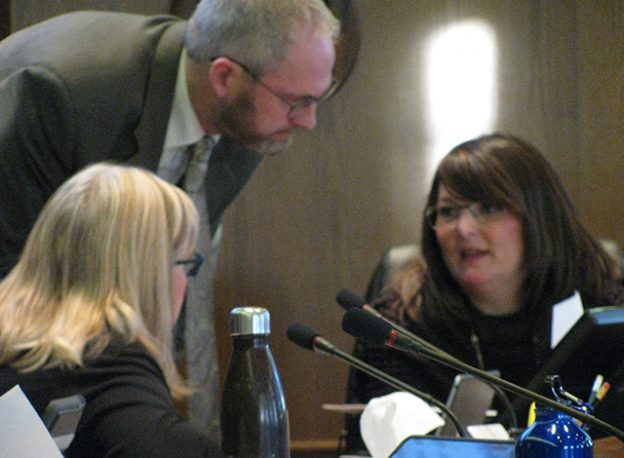 CAO Malcolm Morris talks with Deputy Clerk Nadine Bennett and Councillor Lorraine Allen