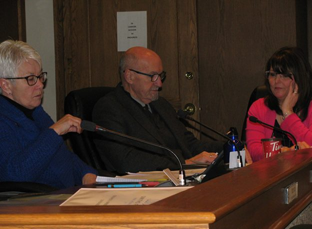 Councillors Alford and McKenna chat with Deputy Clerk Nadine Bennett