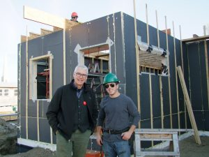 Photo by Chris Must:Chris Hahn, dean of the Perth Campus of Algonquin College, left, chats with second-year construction carpentry student Ryan Dozzi on the site of Habitat for Humanity's first Perth home.