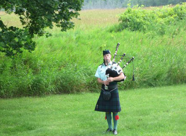 A bag piper playing.