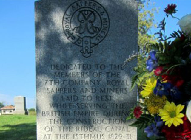 Carving in a memorial head stone dedicated to the members if the 7th company royal sappers and miners laid to rest while serving the British Empire.