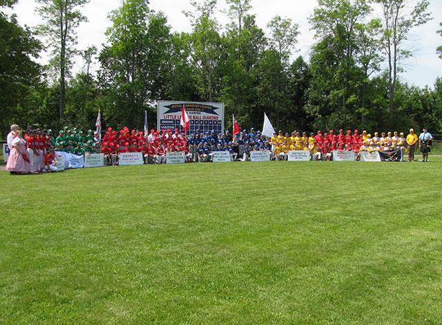 All baseball teams gather for championship photo.
