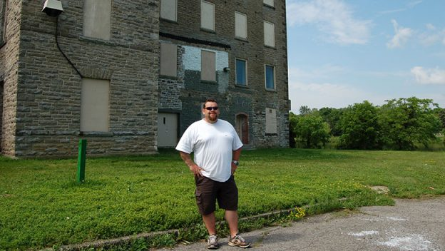 Wally Thorbjornsson standing outside of outside Hawthorne Mill.