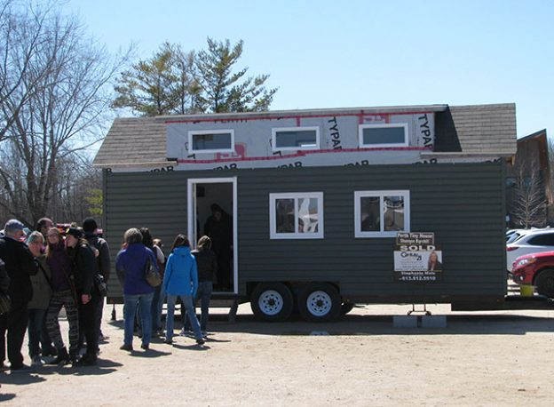Line up to a tiny house at the Perth Tiny House Festival.