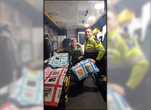 Lanark County paramedic Clint Allan (right) with Almonte Quilters Guild charity coordinator Lisa Compton